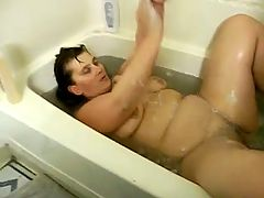 My wife taking a bath gets fisted