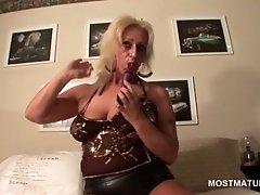 Slutty mature in latex suit riding a vibrator in her cu