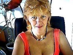 Mature masturbates on webcam