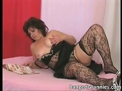 Nasty brunette woman wanking her moist shaved cunt by b