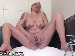 Horny housewife spreading and pleasing her wet mature p