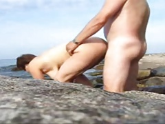 Mature couple having sex on a public beach