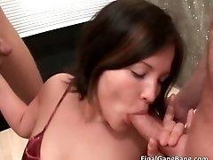 Awesome hot brunette slut sucking two big stiff cocks a