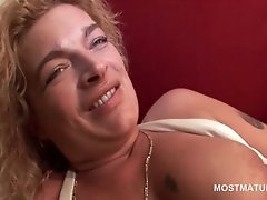 Tempting blonde mature fucking herself with vibrator