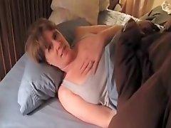 Milf masturbating with a dildo