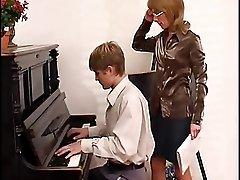 Piano teacher dominates her student