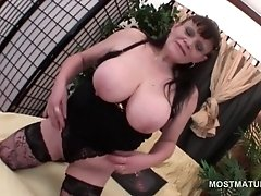Big boobed slutty mature working her craving snatch