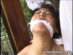 Tied up mature Asian cougar to a house beam