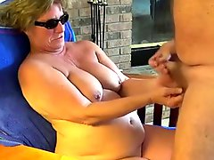Granny Head #23 Sitting on the chair while giving a BJ