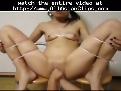 Asian slave fisted and fucked with a bottle in bondage