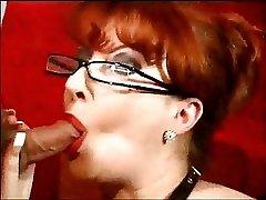Hot redhead MILF takes facial